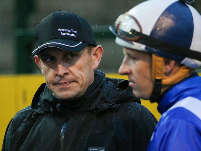 Chris Waller talks with his top stable jockey Hugh Bowman. Picture: Ian Currie