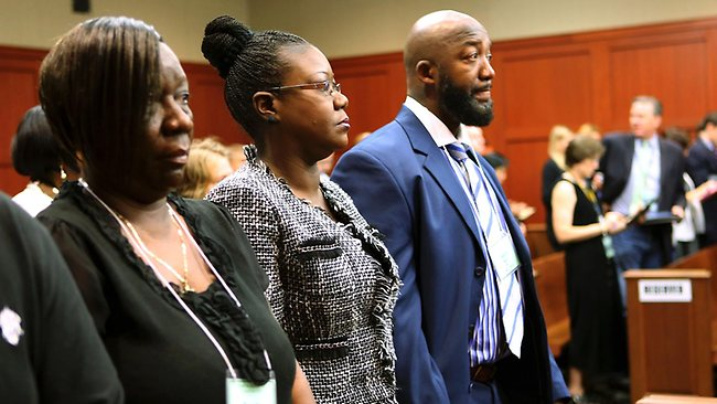 The parents of Trayvon Martin, Sybrina Fulton, centre, and Tracy Martin, right, stand with Trayvon Martin's aunt, Stephanie Fulton Sands, left, as they wait for the jury's arrival in the courtroom.