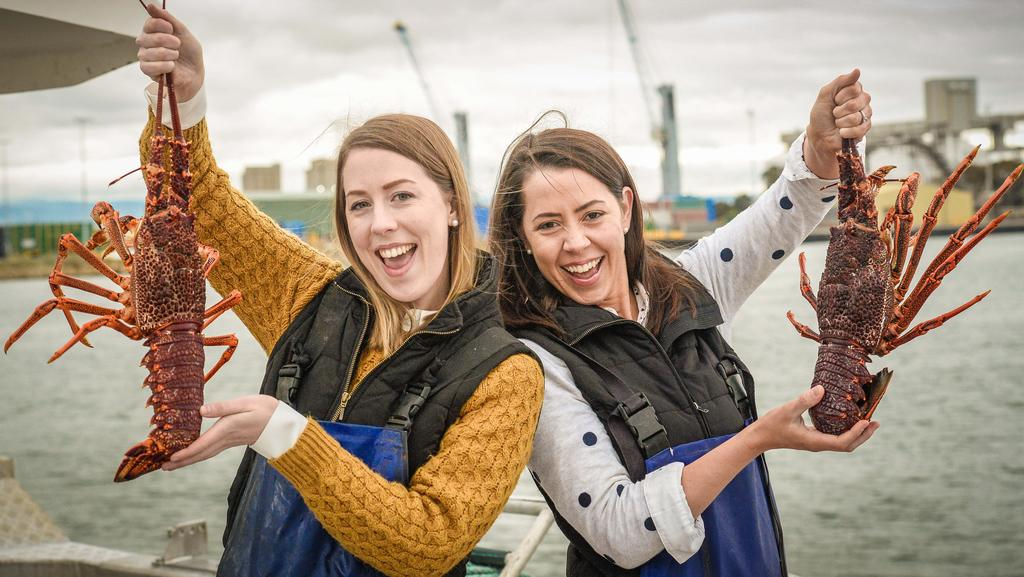 FRIEND OF THE SEA Sisters Eliza Ferguson and Kate Birch on a Ferguson family lobster boat in the Port River. Ferguson Australia has won global sustainable fishing certification for seven South Australian species. Picture: AAP/ROY VANDERVEGT