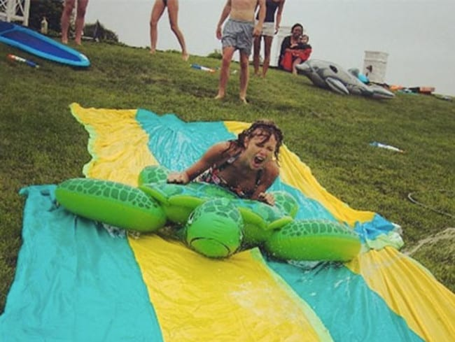 "Taylor Swift spent last weekend at her holiday house on Rhode Island, in upstate New York. Among her celeb guests were Emma Stone and Lena Dunham. The gang cut loose on a DIY slip 'n' slide. Taylor captioned the action shot: ""When the 4th of July gives you nonstop rain, make a giant slip n slide."" Picture: Instagram."
