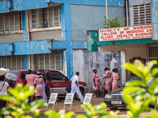 Nurses gather outside the Faculty of Nursing, College of Medicine and Allied Health Services in Freetown, Sierra Leone.