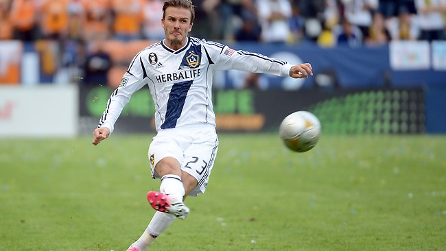 David Beckham whips in a free kick in the second half of the MLS Cup at The Home Depot Center. Picture: Harry How