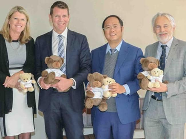 Huang Xiangmo (centre, in blue suit) with NSW Premier Mike Baird during a visit to Bear Cottage in Manly. Picture: ACPPRC