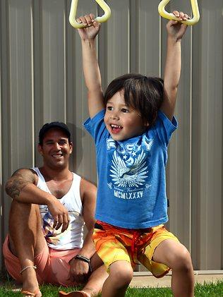 Gavriel Mastromihalis has fun with son Cruz in Adelaide, but keeps a watchful eye over him, too. Picture: Tricia Watkinson.