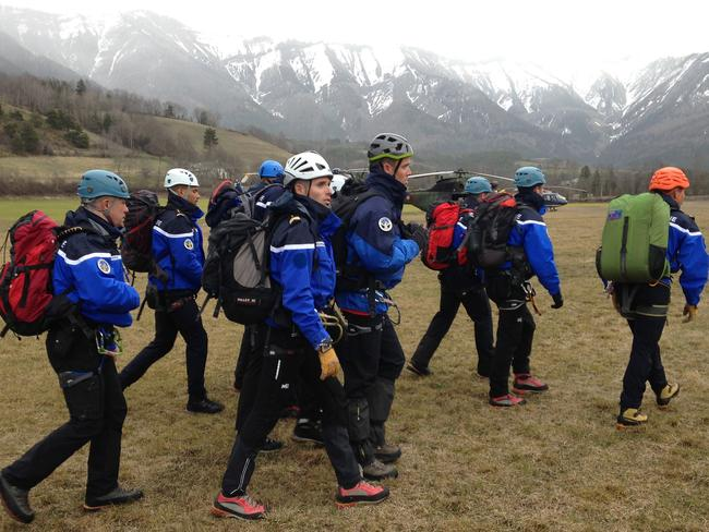 Gendarmerie and French mountain rescue teams arrive near the site of the Germanwings plane crash near the French Alps. Picture: Patrick Aventurier