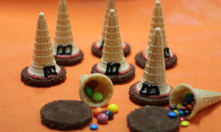 "6. Witches' hats  <p>Did you know you can create a simple lolly treat with ice cream cones and biscuits?</p> <p><a href=""http://www.kidspot.com.au/kitchen/recipes/halloween-witches-hats-2582"">See here for how to make Witches' hat treats for your party table.</a></p>"