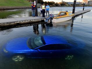 A Holden car slipped down the boat ramp and into the drink at St.Helen's boat ramp. Picture: Jay Town