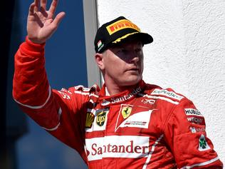 (FILES) This file photo taken on July 30, 2017 shows Ferrari's Finnish driver Kimi Raikkonen waving after placing second in the Formula One Hungarian Grand Prix at the Hungaroring racing circuit in Budapest. Kimi Raikkonen has signed a one-year contract extension with Ferrari for the 2018 season, the Formula One team announced on August 22, 2017. / AFP PHOTO / ANDREJ ISAKOVIC