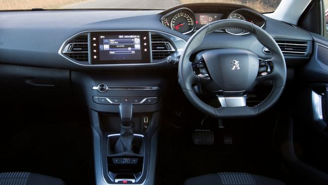 Mod cons: the 308's update includes updated touchscreen, hands-free parking and a suite of driver assist safety tech.