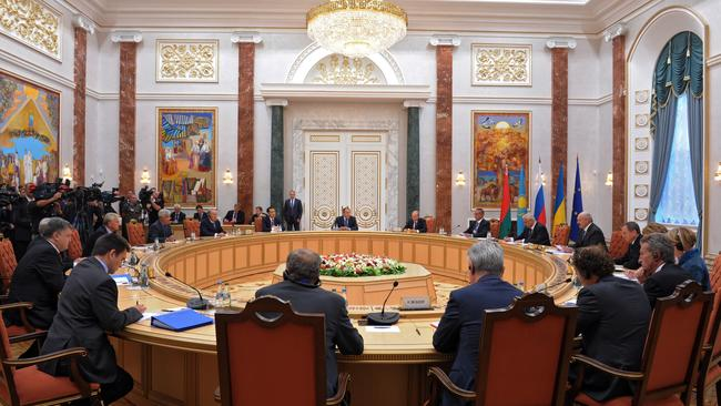 Time for change ... Russian President Vladimir Putin, back right, and Ukrainian President Petro Poroshenko, left, attend talks in Minsk, Belaru. Picture: AP