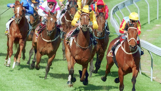 In a battle for the ages, chased down Sunline (right) in the final straight to win the 2002 Cox Plate. Picture: Joe Mann