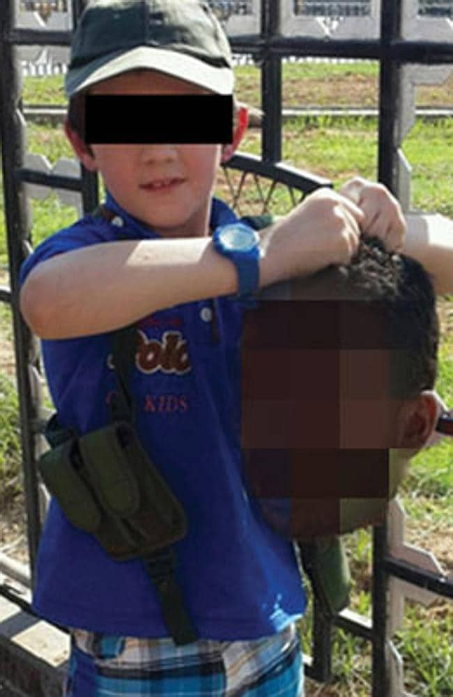 Khaled Sharrouf's son holding a severed head / Picture: Supplied