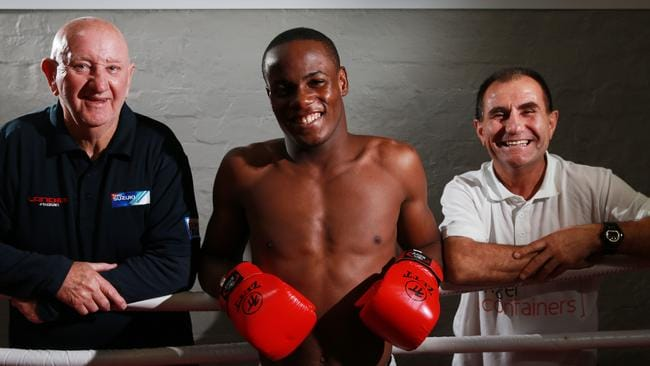 West Indian boxer Laured Stewart with trainer Johnny Lewis, left, and Peter Mitrevski.