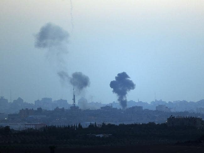 Smoke rises ... Israeli strikes on Gaza, seen from Israel-Gaza Border. Picture: Lefteris Pitarakis