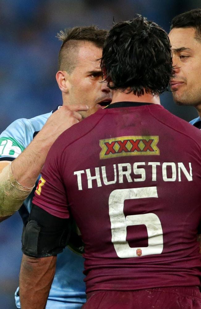 Josh Reynolds and Johnathan Thurston have words after Thurston used an elbow to Reynolds' throat during Game 2 of the 2014 State of Origin series.