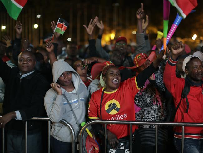 Supporters of Kenya's President Uhuru Kenyatta cheer as they await an expected announcement of election results. Picture: AP