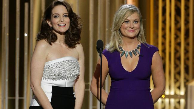 Tina Fey, left, and Amy Poehler in their second outfits of the night.