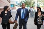 O.J. Simpson, center, arrives with his sister Carmelita Durio, left, and his daughter Arnelle, for the start of closing arguments in his trial at the Clark County Regional Justice Center Thursday, Oct. 2, 2008, in Las Vegas. Simpson is charged with twelv