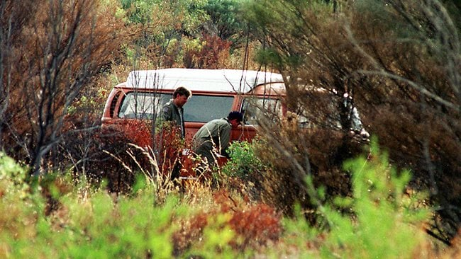 NT police check a Kombi van found off the Stuart Highway after British tourists Peter Falconio and Joanne Lees were stopped by a man in a 4wd ute who subsequently shot Peter.
