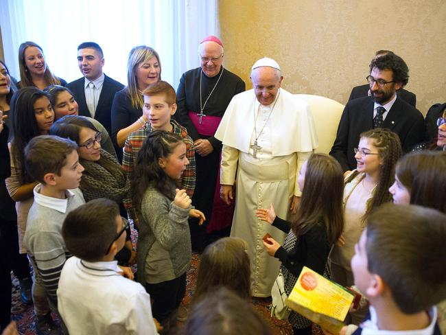 Blessings ... Pope Francis meets with Catholic groups during a private audience at the Vatican. Picture: AP Photo/L' Osservatore Romano