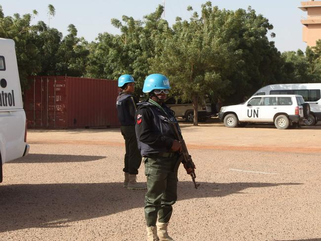UN peacekeepers standing guard near Timbuktu's airport where a rocket and car bomb attack left one UN peacekeeper dead, a dozen wounded. Picture: AFP Photo