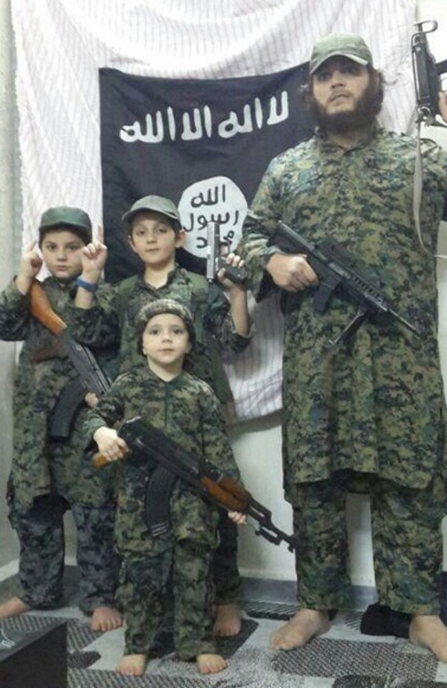 Australian born and bred ... Terrorist Khaled Sharrouf and his young sons in Syria standing in front of the flag of the Islamic State. Picture: Twitter