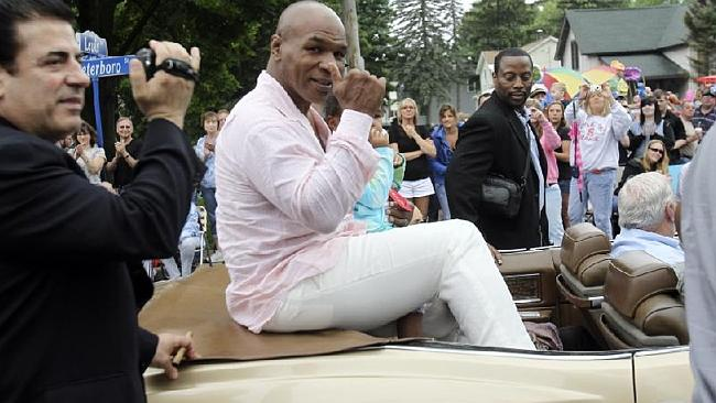 Tyson and daughter, Milan, from his third marriage, at a 2011 Boxing Hall of Fame parade in New York. Picture: AP.