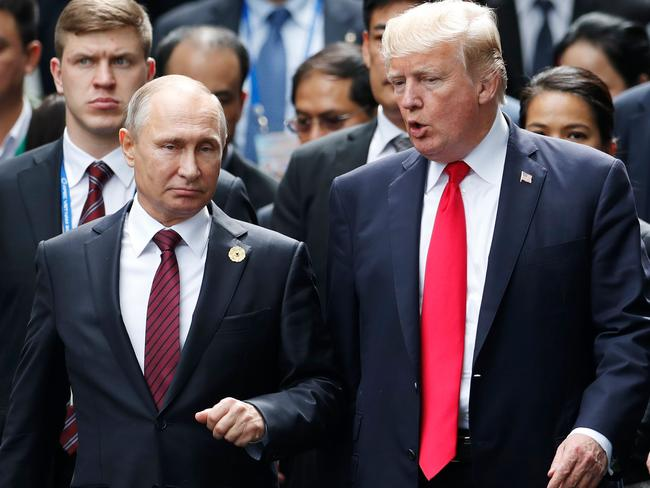 US President Donald Trump (R) and Russian President Vladimir Putin talk during the Asia-Pacific Economic Cooperation (APEC) leaders' summit. Picture: AFP