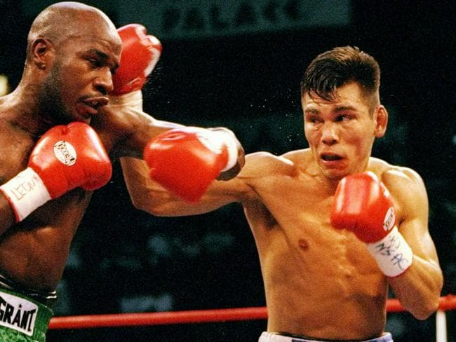 Keith Mullings (left) fights Raul Marquez.