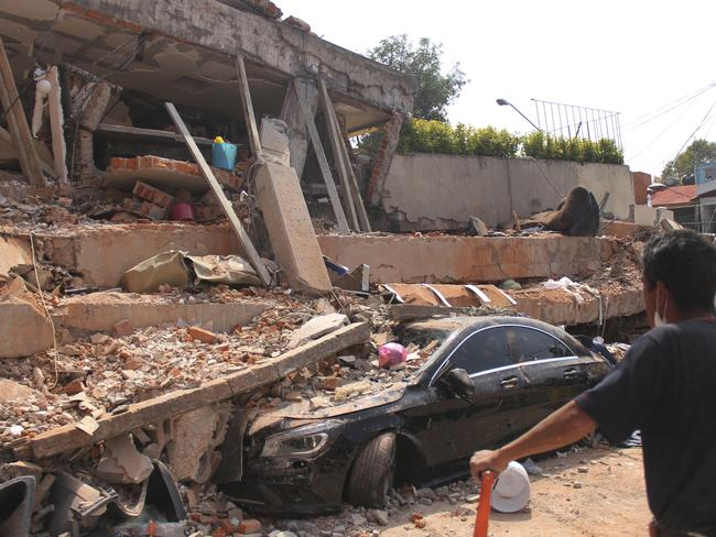 A car lays crushed under the collapsed Enrique Rebsamen school in Mexico City. Picture: AP
