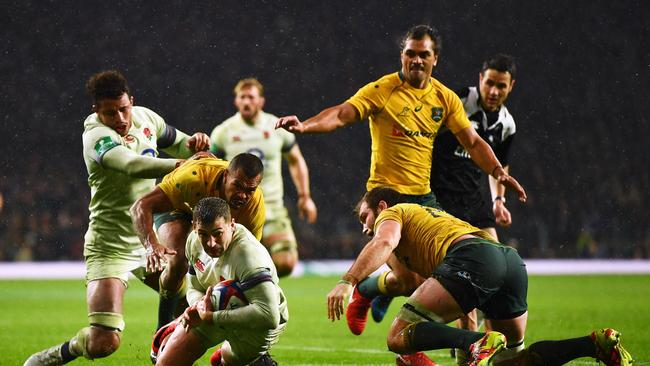 Jonny May of England goes over to score his side's third try at Twickenham.