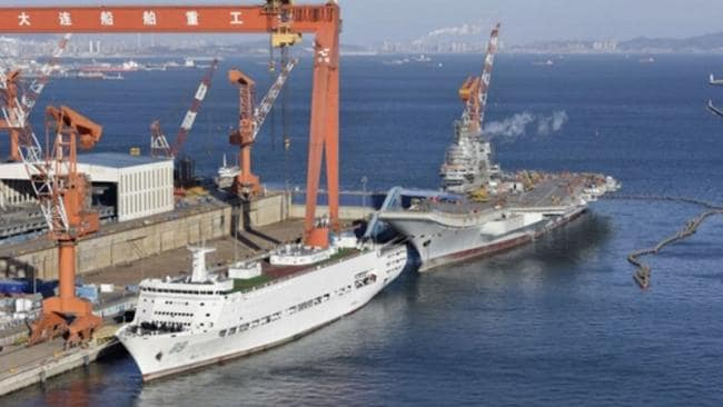 This image shows a Chinese carrier trials support ship berthed in Dalian next to the country's newest aircraft carrier. Source: Sina
