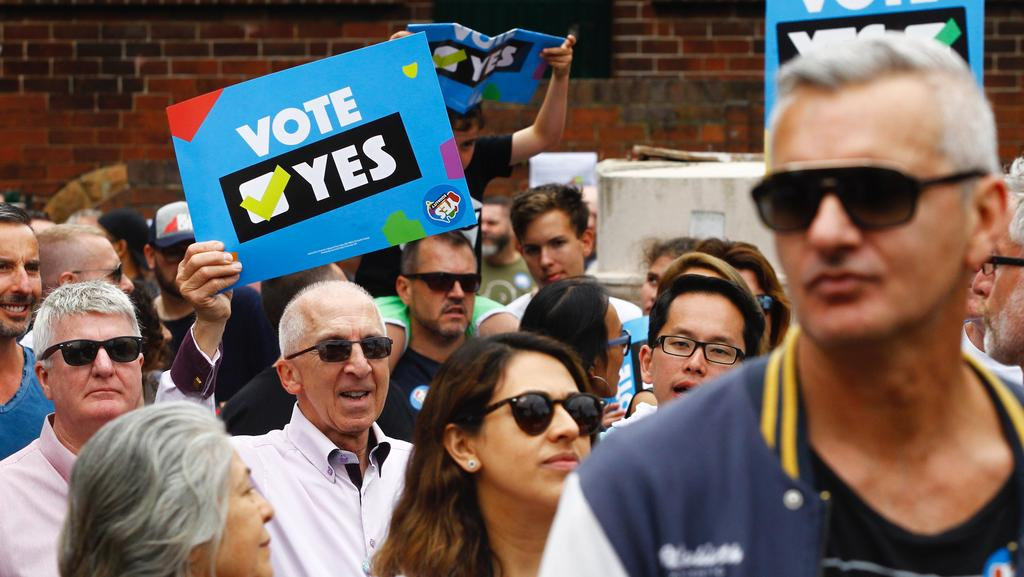 Supporters of marriage equality are seen at the Post Your Yes Vote Street Party at Taylor Square in Darlinghurst, Sydney. PayPal will today launch its donation-matching scheme supporting marriage equality. Picture: AAP Image/Danny Casey