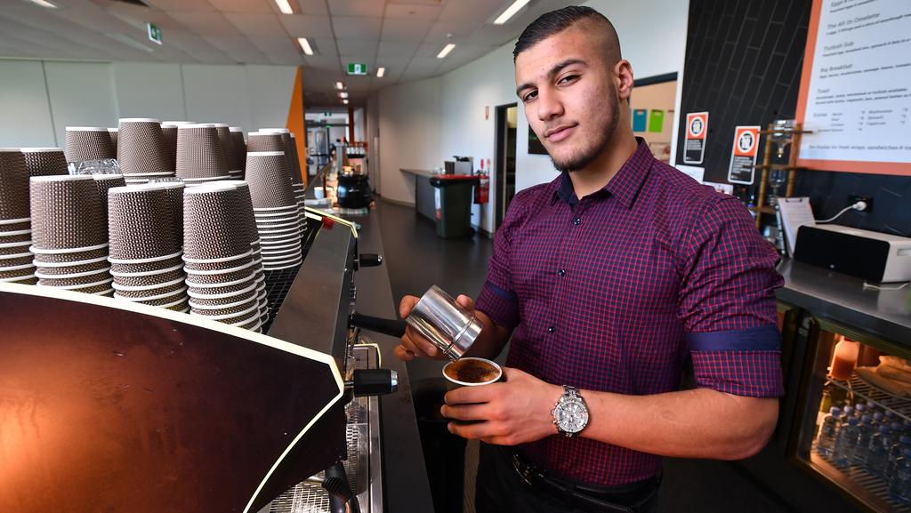 S1 Nas Alqaisi Makes A Coffee At The GWS Giants Cafe Sydney Olympic