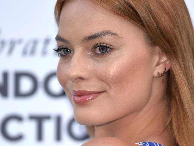 Margot Robbie attends the One For The Boys charity ball in London.