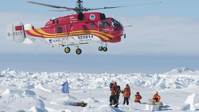 The Chinese helicopter, which landed on a makeshift landing pad next to the marooned ship, ferried the scientists, tourists and journalists in groups of 12 to an Australian government supply ship, the Aurora Australis. Picture Jessica Fitzpatrick/Australian Antarctic Division/AFP