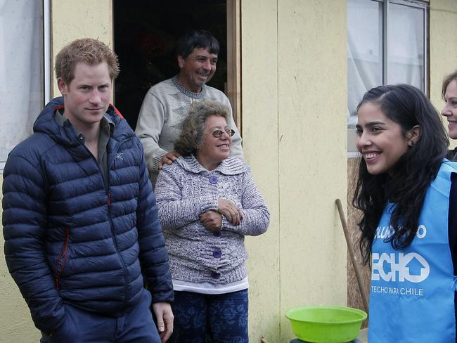 Chile tour ... Prince Harry visits families in El Vergel, a slum in Valparaiso that was completely burnt down during a fire last April. Picture: Eliseo Fernandez