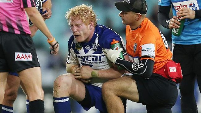 James Graham after copping a shoulder charge from the Roosters' Dylan Napa. Picture: Mark Evans