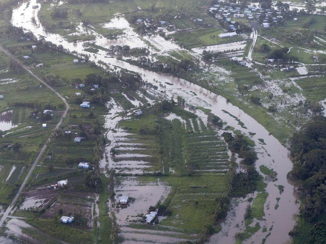 This picture taken from a Royal Australian Air Force C-17A Globemaster aircraft reveals the widespread flooding in Fiji caused by Tropical Cyclone Winston.