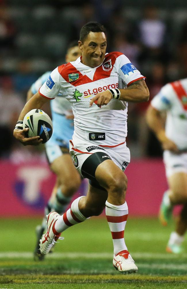 Benji Marshall finds space and makes a break against the Sharks.