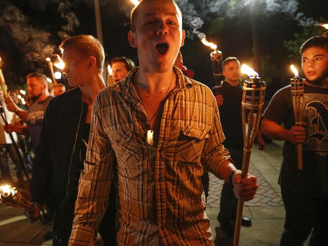 Multiple white nationalist groups march with torches through the University of Virginia campus in Charlottesville on Friday night. Picture: Mykal McEldowney/The Indianapolis Star via AP