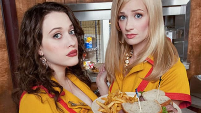 Actors Kat Dennings (L) and Beth Behrs from the TV program 2 Broke Girls.