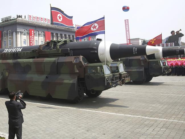 A North Korean KN-08 Intercontinental Ballistic Missile (ICBM) is paraded across Kim Il-sung Square during a military parade in Pyongyang on Saturday. Picture: Wong Maye-E/AP