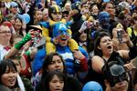 <p>The crowd of 1,580 costumed superheroes cheer during the successful attempt to break the Guinness World Record for the largest gathering of superheroes outside the Staples Centre in Los Angeles, California 02/10/2010.</p>