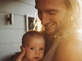 Surfer Owen Wright with his son Vali. Picture: Corey Wilson.