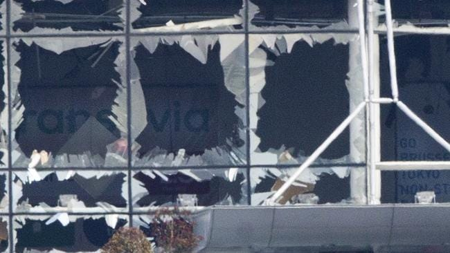 The blown out facade of the terminal is seen at Zaventem airport, one of the sites of two deadly attacks in Brussels. Picture: AP Photo/Peter Dejong