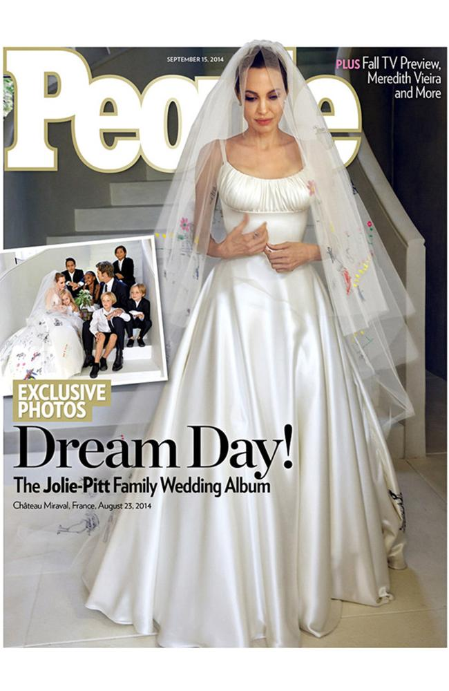 Stunning bride ... Angelina Jolie in her dress partly created by her kids. Picture: People Magazine
