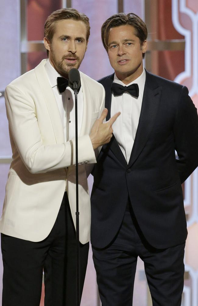 Presenters Ryan Gosling and Brad Pitt speak onstage during the 73rd Annual Golden Globe Awards at The Beverly Hilton Hotel on January 10, 2016 in Beverly Hills, California. (Photo by Paul Drinkwater/NBCUniversal via Getty Images)