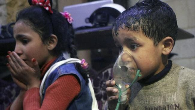 A child receiving oxygen through respirators following the alleged poison gas attack. Picture: AP