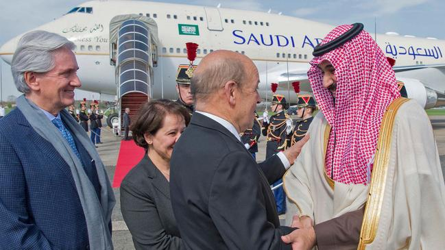 """CORRECTION - French Foreign Affairs Minister Jean-Yves Le Drian (2nd-R) welcomes Saudi Arabia's crown prince Prince Mohammed bin Salman (1st-R) next to French Ambassador to Saudi Arabia Francois Gouyette (1st-L) at Le Bourget airport, north of Paris, on April 8, 2018. Saudi Arabia's crown prince Prince Mohammed bin Salman arrived in France on April 8, for the next leg of a global tour aimed at reshaping his kingdom's austere image as he pursues his drive to reform the conservative petrostate. / AFP PHOTO / Saudi Royal Palace / BANDAR AL-JALOUD / RESTRICTED TO EDITORIAL USE - MANDATORY CREDIT """"AFP PHOTO / SAUDI ROYAL PALACE / BANDAR AL-JALOUD"""" - NO MARKETING - NO ADVERTISING CAMPAIGNS - DISTRIBUTED AS A SERVICE TO CLIENTS / """"The erroneous mention[s] appearing in the metadata of this handout photo by the Saudi Royal Palace has been modified in AFP systems in the following manner: [Saudi Royal Palace] instead of [Ahmed Nureldine]. Please immediately remove the erroneous mention[s] from all your online services and delete it (them) from your servers. If you have been authorized by AFP to distribute it (them) to third parties, please ensure that the same actions are carried out by them. Failure to promptly comply with these instructions will entail liability on your part for any continued or post notification usage. Therefore we thank you very much for all your attention and prompt action. We are sorry for the inconvenience this notification may cause and remain at your disposal for any further information you may require."""""""